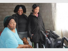 Gogo Magdalene Khoza (left) will now use her new wheelchair with ease inside her home, seen here with Margret Mabena and her daughter Nothando Khoza.