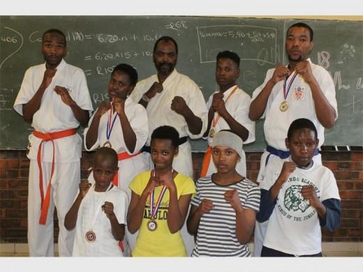 Tsakane Kyokushinkan Club students who succeeded in the tournament (back left): Thulani Nkambule, Mathapelo Sibeko, sensei Linda Ngubane, Kamohelo Nyepetsi and Siyabonga Mahlangu. (Front from left): Ndinga Dyongo, Ntokozo Ngubane, Mpho Mokoena and Sibongiseni Mokoena.