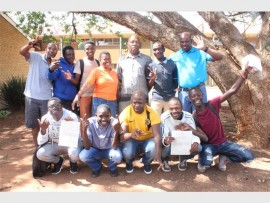 Phulong Secondary School staff celebrate with their matriculants.