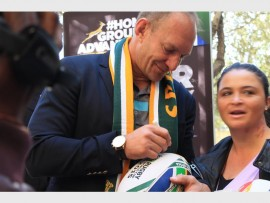 FAN FAVORITE: Francois Pienaar spends time with his fans, happy to autograph their rugby memorabilia.