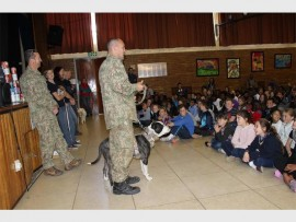 Raise awareness... Carl Thornton, founder of Pit Track with Diego, at a presentation to the pupils at Edenglen Primary School about homeless animals and canine conservation.