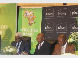 African leaders… Jean Pierre Elong Mbassi, Parks Tau and Mpho Nawa at the Africities Summit media briefing at the Sandton Convention Centre.