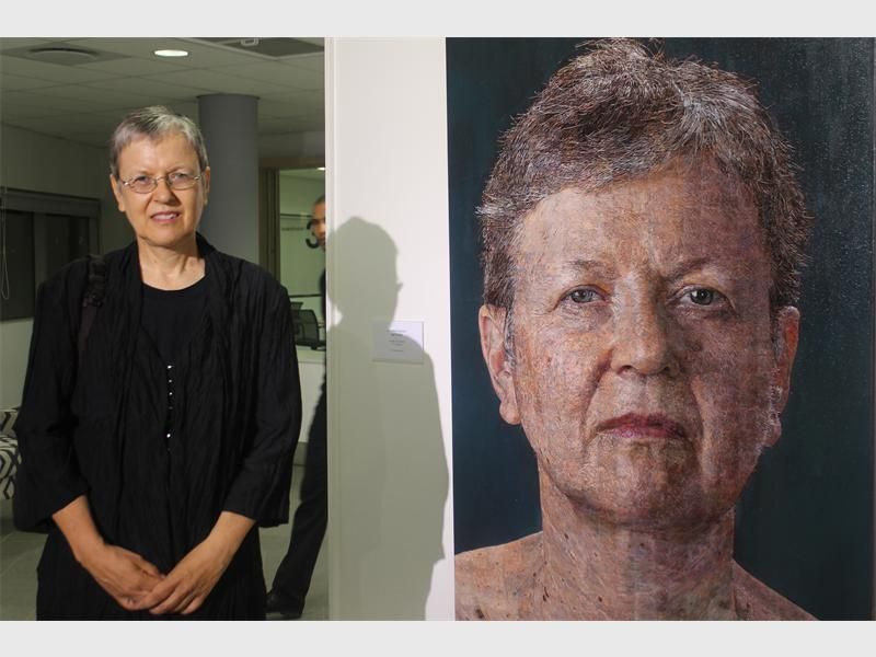 Work of art… Anette Pretorius stands next to her self-portrait which she created over a period of six months.