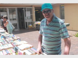 Reader... Local resident Danny Vann looks through the books at the monthly book sale.