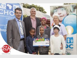 Carl Queiros, CHOC CEO; Herman Botha, PNA group general manager; and Sadie Cutland, CHOC founder with some of the children at the CHOC House.