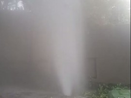 Water gushes from burst pipe on Chesham Road in Bryanston.