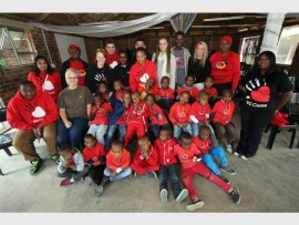 Giving back... Varsity College's team together with 20 young courageous boys from the Phutaditjaba Community Centre at the Lory Park Zoo.