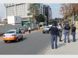 Aftermath... Police officers on the scene after meter taxi drivers threw stones at Uber taxi drivers which were travelling on Rivonia Road and West Street.