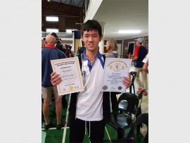 Chad Himlok receives provincial and national colours for archery.