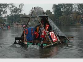 Water fun... Scout members on their raft.