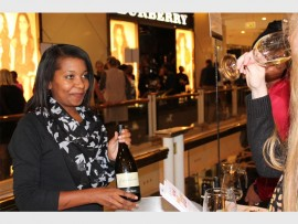 Tasting... Natashia Nkonjera represents Jean Daniel wines at the Old Mutual Wade Bales Wine & Malt Whiskey Affair at Hyde Park Corner..