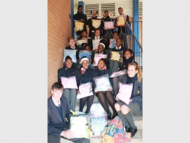 Giving back... The pupils of Hyde Park High School with some of the gift packs that will be donated to new mothers.