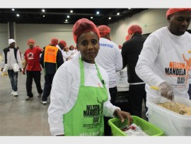 Charity... Mavis Vilakazi packs food at the Nelson Mandela Day initiative.