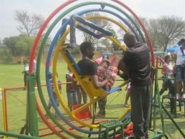 A young man enjoys a ride at a previous fun day.