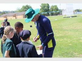 Proteas batsman David Miller signs autographs at St Stithians Boys' College.