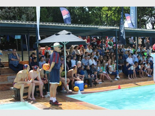 Coaches, teammates, peers and families all support their school's water polo teams.
