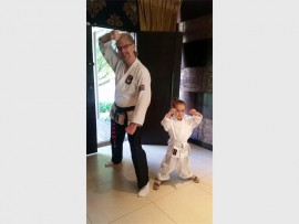 Sensei Gary Mclean with his youngest student, three-year-old Scarlet Calder, who won three medals at the recent karate championships.