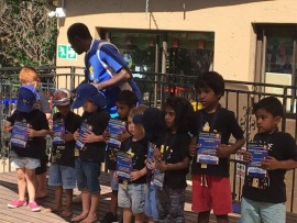 The children of Junior Colleges Tiny town with their soccer certificates.