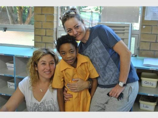 Janine Joselowitz and Joanne Nomis say goodbye to Ella Nomis.