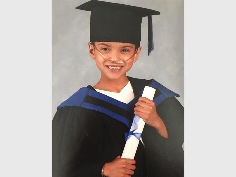 Ayaan had to wear his oxygen machine at his school graduation last year.