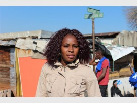 """Ms Nolufefe Mangwana said, """"I'm not happy because I'm living in a shack. After the elections I would like to see more job opportunities being available as I'm currently not working and that makes life difficult. I cannot afford to rent a proper place. Better housing and job opportunities is my wish for after the elections."""""""
