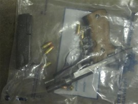 Unlicensed firearm and ammunition that was confiscated.