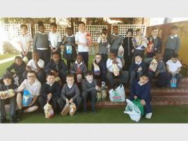 Glenoaks School pupils get ready to make sandwiches.