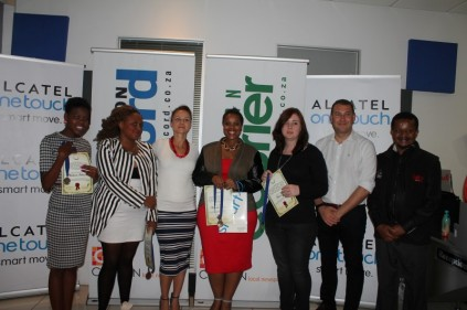 *File Image: Prize Giving Ceremony from 2014. Second place, Noluthando Sikhosana, third place Angela Mthembu, MD at Brandfluent and Caxton Creative Writing Competition judge, Bryony van Zyl, Winner Nomandle Ndwandwe, Chelsey Roux, Alcatel One Touch Southern Africa Country Manager Ernst Wittmann and Head of Caxton Creative Writing Malcolm Maifala.