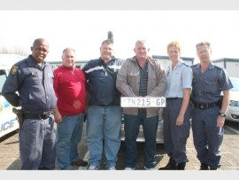 CAUGHT IN THE ACT: Police officers of the Brackendowns Police Station's Crime Prevention Sector 1 Unit, in front of the silver Mercedes, holding the number plate which was pasted onto another one. From the left are: Sgt.Boikanyo Tlala, Geoff Steyn, Capt Chris Buys, Capt Lourens Engelbrecht, Capt Antoinette Foord and Lieutenant Colonel Frank Hutchons.