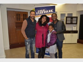 CELEBS MAKE AN APPEARANCE: Ashish Gangapersad and Sisa Hewena, both from Isidingo, made an appearance at the Popular Furniture Store in Alberton Boulevard on Saturday, July 25. The two took time to mingle with the customers. They are seen here with Thuli Radebe and her daughter Asanda.