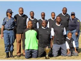 "TEAM PLAYERS: Front: WO Joel Khumalo, Sgt Christian Motikwa, Michael Sithole and Kamogelo Moloi pose with the team's trophy. Back: Const Nokwanda Mphithi, Const Obed Mashamaite, Const Mziwoxolo Diyantyisi, Const Thabani Mthetwa, Sgt Tshepo Padi,  ""Bongsta"", Sgt Lindi Moloi."