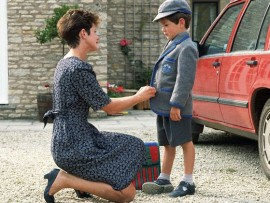 A mother prepares her son for his first day at school. --- Image by © Jennie Woodcock; Reflections Photolibrary/CORBIS