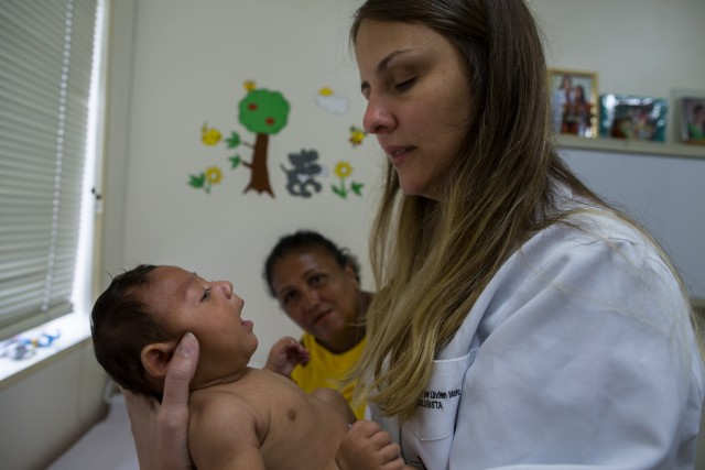 20 Jan 2016, Recife, Brazil --- Nadja Gomes Bezerra, 42, telemarketing operator, takes his daughter, Alice, in a medical consultation with Dr. Vanessa Van Der Linden. The Zika virus, first detected about 40 years ago in Uganda, has long seen as a less-painful cousin to dengue and chikunguya, which are spread by the same Aedes mosquito. Brazilian health authorities are convinced that microcephaly is related to the Zika virus when a pregnant woman is bitten by this bug. This rare condition known as microcephaly, often results in --- Image by © FLAVIO FORNER/Xibe Images/Corbis