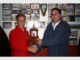 CRICKET CHAMP: Heinrigh Pieterse (left), receives his prize from Alberton Cricket Club chairman, Stef Duvenage.