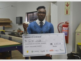GIFT'S GIFT: Gift Lubele at the Tembisa Fabrication laboratory, holding his smart plastic invention that won him first place at the 2015 Teenpreneur competition.