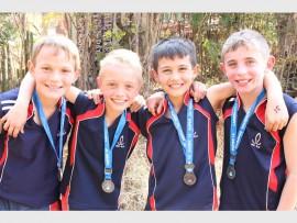TWEEDE: Die Randhart seuns se o.10 landloopspan (van links): Darius Haasbroek, Caleb Short, Ethan Murrat en Wian Steenkamp.  Darius kry 'n goue medalje as wenner van die wedloop .