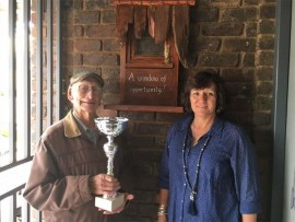 DIFFERENCE MAKERS: Arthur Cunningham is honoured for a work of art he donated to the school. He is holding the Arthur Cunningham Window of Opportunity trophy, and is seen with the director of the school, Morgen Maherry.