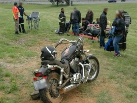 THE SCENE: The motorcycle of the patient belies the serious state he is in.