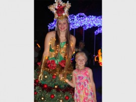 FUN: One of the Christmas characters with Zelri Coetzee at the Garden of Lights.