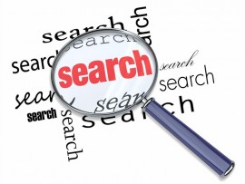 A magnifying glass hovering over the word Search