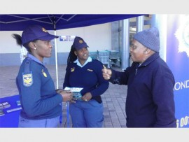 INFORMING: Shirley Gqoba  (social crime prevention officer) and Sibongile Elizabeth Mnguni (Mondeor SAPS communication officer) chat to one of the shoppers at Southgate Mall.