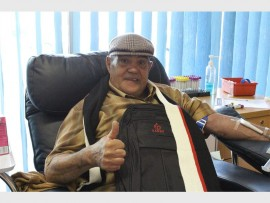 MILESTONE: John McIntyre donates his 300th unit of blood at the Southdale blood bank on Mandela Day (Monday July 18). He is seated with his SANBS backpack and scarf.