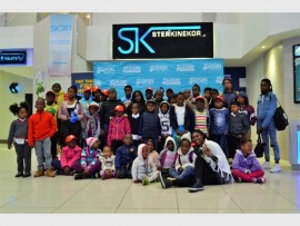 FUN: Nozipho Khumalo, Southgate marketing manager (seated, second from right) poses with the children.