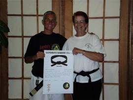 SADLY MISSED: Bobby Vincent receiving her honourary black belt from sensei Sandra Louw.