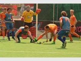 NO GOAL: Maropeng Cavemen men's hockey team (orange) won the first Premier Hockey League title. Photo: Annette van Scahlkwyk