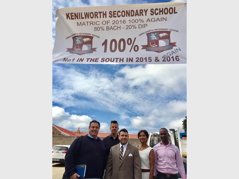 PROUD: Clr Tyrell Meyers, clr Michael Crichton, Manny de Freitas MP, Kammy Dhanphat (representative from the school district) and Morgan Radebe (school principal) are proud of the school's success for the second consecutive year.