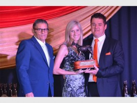 CHAMPIONS OF THE SEASON: Receiving their biggest award for the season - Horse of the Year, award from Larry Weinstein CEO of the Racing Association are Rika and Adriaan van Vuuren on behalf of Abashiri. Photo: Annette van Schalkwyk