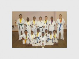 SHOWING THEIR SKILLS: The karatekas who did well in the tournament are, front: Tshegofatso Kgage. Middle: Aiden Taaibos, Siabonga Vilakazi, Ndumiso Zulu, Kutlwano Meje, Kamogelo Kekana and Tyrique du Plessis. Back: Courtney Daniels, Reatlegile Ramaroko, Mbali Lamula, Senpai Sherilyn Onslow, Tamryn Greeff, Donel Du Plessis and Gayle Jacobs.