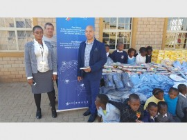 DONATIONS: Phindile Zwane (Bona Electronic Solutions), Wayne Schoeman and Tonny Khumalo (Bona Electronic Solutions) during the recent donation handover.