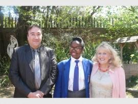 Pictured here are Mr A Antoniou (science teacher), Bathobile Masina and Mrs V Nicolaou (school principal).
